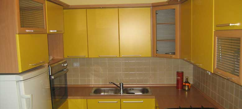 Yellow color custom kitchen of MDF and chipboard